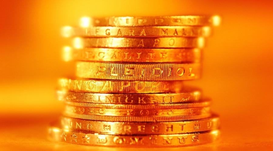Aranyérmék egymásra halmozva - a sárga nemesfém szép hozamot hozott a tavaly decemberben befektetőknek