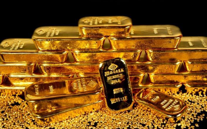 Aranyrudak felhalmozva - rekord közeli befektető kereslet a befektetési arany iránt.