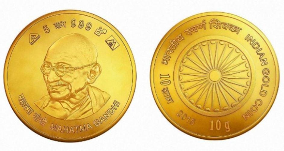 Indiai befektetési aranyérme Gandhi arcképével.