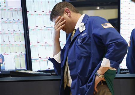 Kötvénypiaci kereskedő a New York-i értéktőzsdén. Forrás: Reuters, Conclude Zrt.